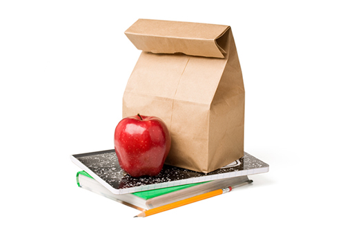 Image of lunch bag and apple to signify lunch and learn session